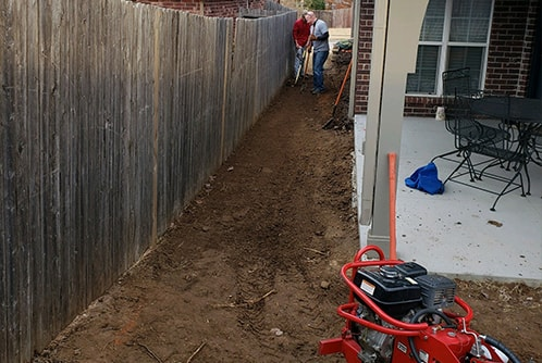 regrading the yard between house and fence